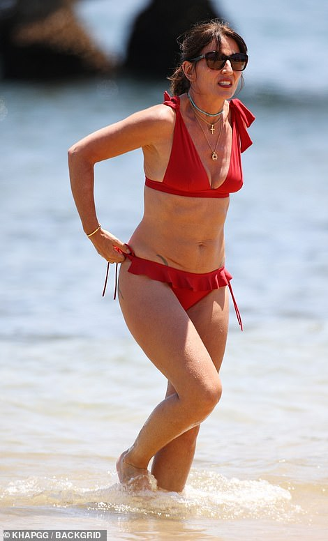 Energetic: During her time in the sun, Davina enjoyed a run through the ocean