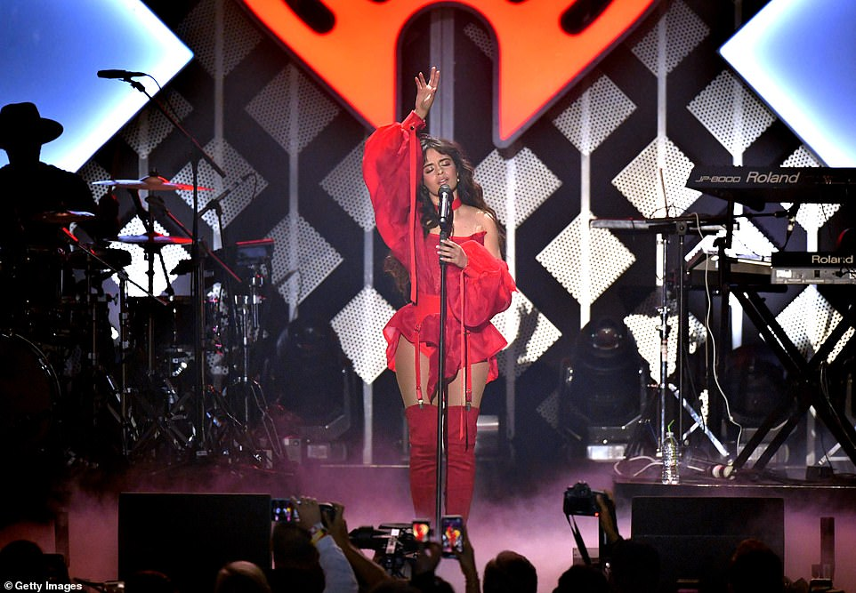 Standing tall: Camila boosted her petite height in her fancy footwear which was attached to her belt