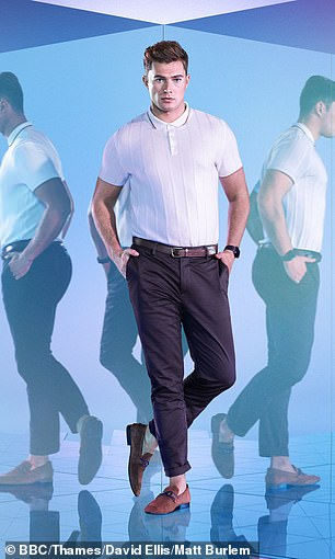 Hunk: The ballroom pro sported a polo shirt with dark wash trousers