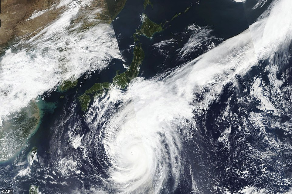 Satellite photo taken on October 10 by NASA-NOAA's Suomi NPP satellite shows typhoon Hagibis approaching Japan