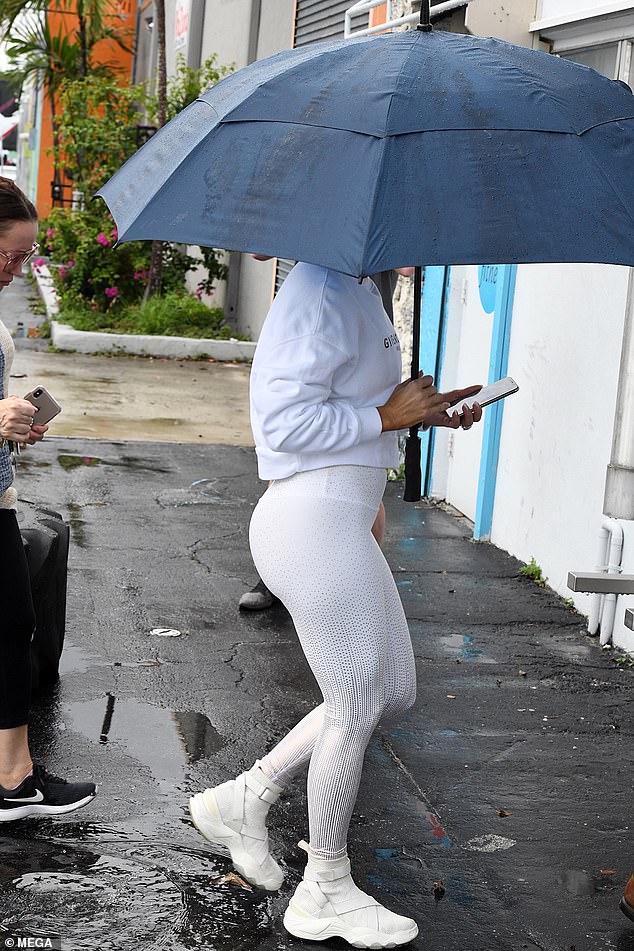 Legs 11 (out of 10!): Here Jennifer shows off her famous legs and booty while keeping dry