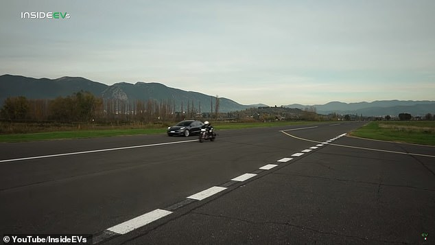 But the bike, which is much lighter, catches up to the Tesla and eventually overtakes it, winning the race