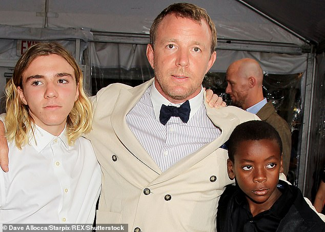 Family: On Monday Guy 9pictured in 2015 with Rocco and David Banda) filed a motion in his divorce case with ex wife Madonna asking for 'the enforcement or execution of a judgment or order'. The timing of this suggested there could be a disagreement over where some of their children should spend Christmas