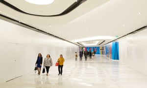 People walk past uncompleted retail areas at the American Dream mall.