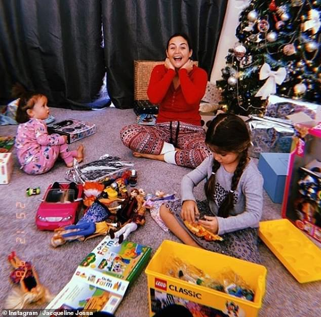 Wow! Jacqueline shared a glimpse of the array of gifts Mia and Ella received for Christmas, in a snap of their living room laden with toys