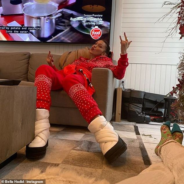 Wild and crazy:Bella also shared another snap on her Instagram of her lounging on the couch in the same outfit, which she captioned, 'Another wild and crazy Xmas'