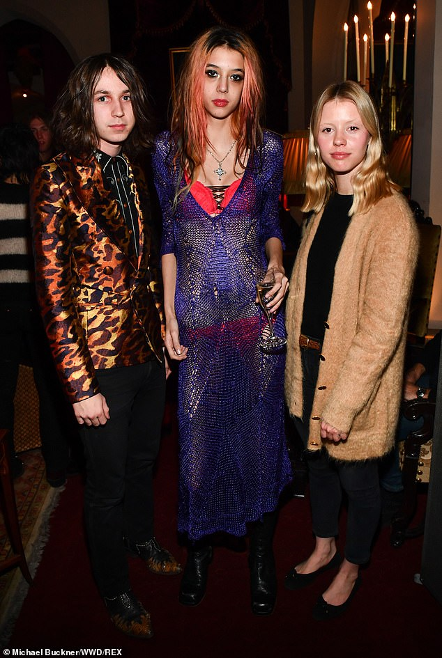 Party time: Goth also posed for photos with Arrow de Wilde and Henri Cash of LA indie rock band Starcrawler