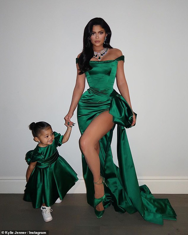 Christmas spirit: Kylie Jenner was definitely in the Christmas spirit on Tuesday, rocking a matching green dress with her daughter Stormi as they made their way to the annual Kardashian family Christmas party