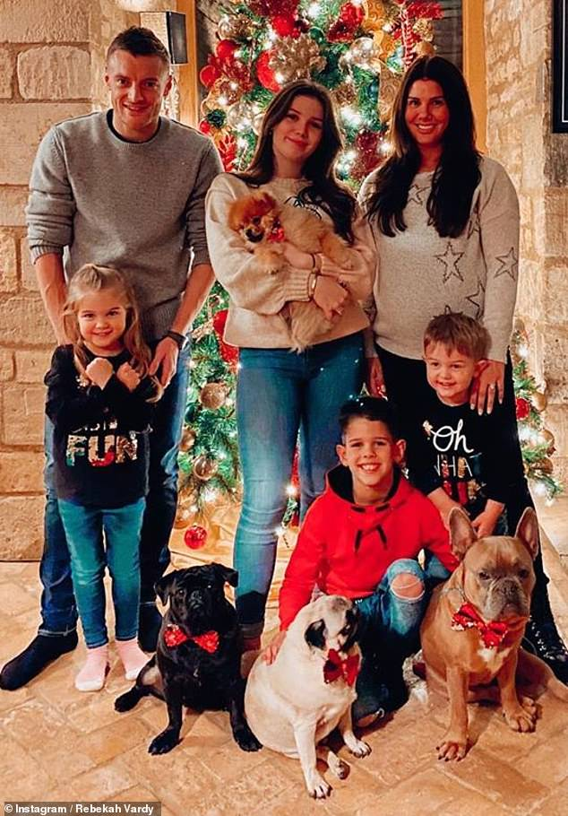 Happy family: Awaiting her baby's arrival, Rebekah took to Instagram on Christmas Eve (Tuesday) to share a festive snap with her family