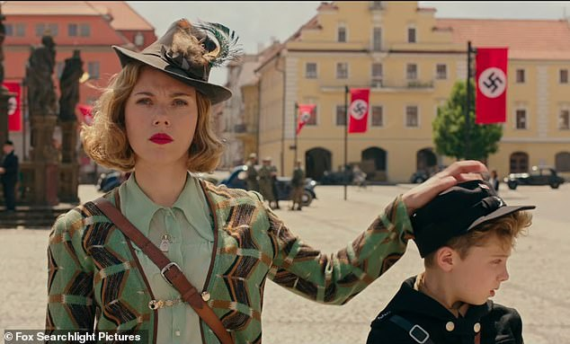 Scarlett Johansson (left) andRoman Griffin Davis (right) star in the new film Jojo Rabbit