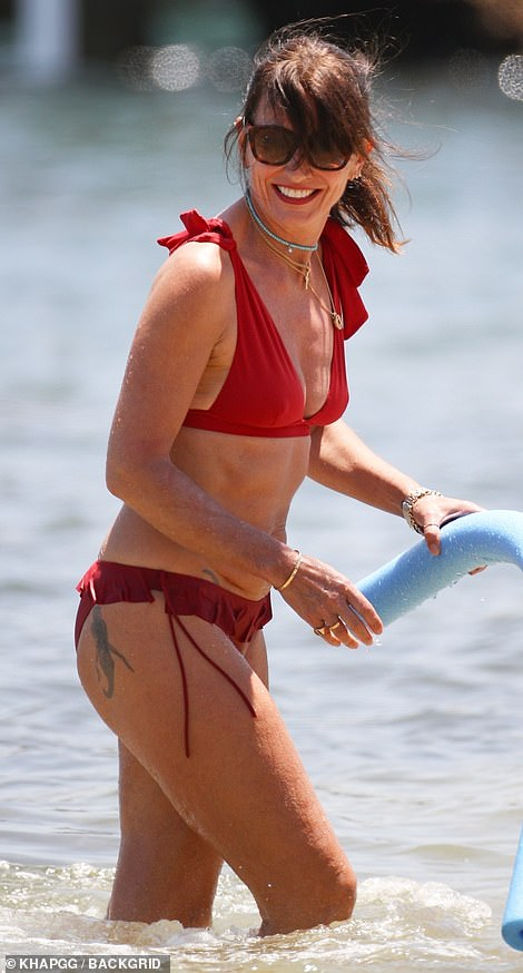 Holiday: The mother-of-three looked sensational in the colourful two-piece during her sunny getaway