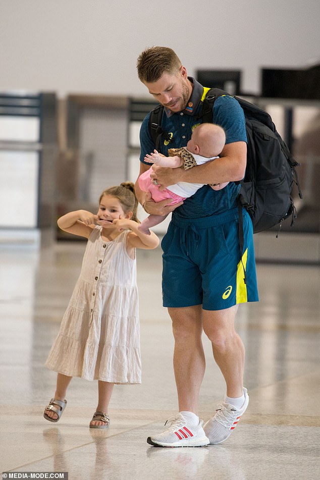 They're a handful! While David cradled baby Isla, his eldest daughters, Ivy Mae, five, and Indi Rae, three, played around and pulled faces in the terminal