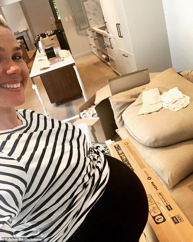 After: Before giving birth, Edwina shared this selfie showing her finished kitchen behind her