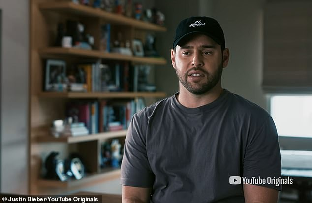 His manager: Scooter Braun also makes an appearance to talk about the success of the young star before saying:'No one in the history of humanity has grown up like Justin Bieber'