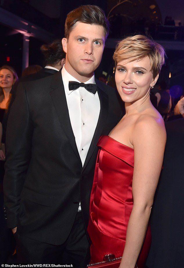 Scarlett's partner is Colin Jost (left), a comic, actor and head writer on New York's legendary satire show Saturday Night Live