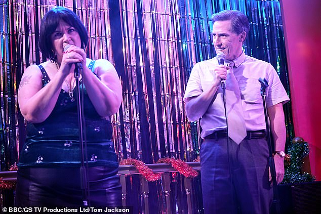 Song:Ruth Jones defended the word 'f****t' being used in the special where the characters perform a rendition of Fairytale of New York (pictured on stage with Rob Brydon)