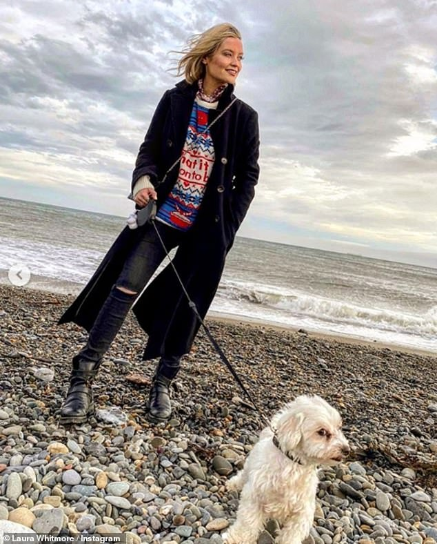 Dog days: Laura, who stayed in touch with Iain over FaceTime during the festive period, donned a festive jumper in aid of Save the Children as she posed with her dog Mick