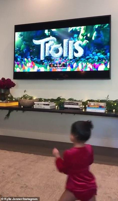 Happy kid: KJ's daughter Stormi got ready to watch the Trolls movie