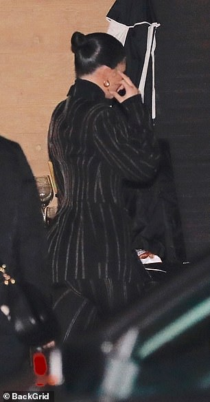Va va voom! Jenner had heads turning with her suit clinging to her curves