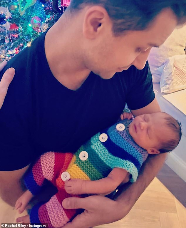 Sweet: Doting dad Pasha is seen lovingly cradling the little girl in another heartwarming image
