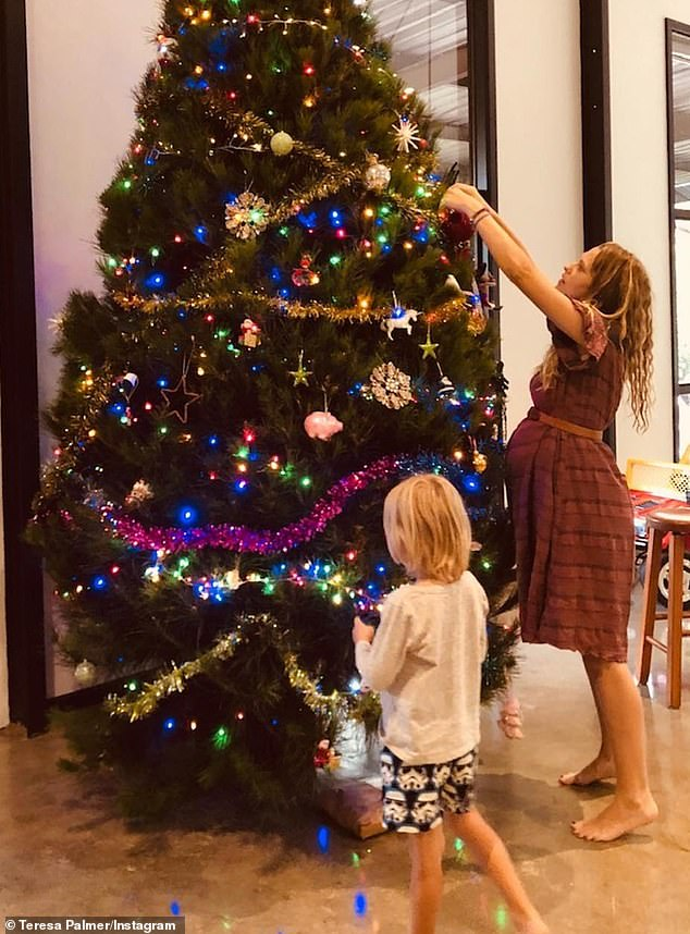 Last Christmas: Teresa decorated the tree with her children while pregnant with her third child, daughter Poet Lake