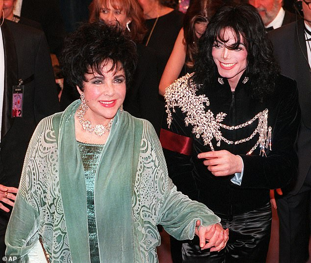 Prize piece: The jacket was worn by the late pop-star for Elizabeth Taylor's 65th birthday party in 1997 (pictured) - and sold for $65,625 in October