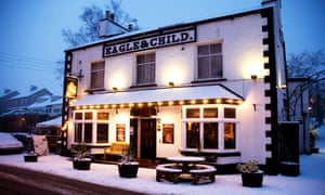 The Eagle and Child exterior with snow