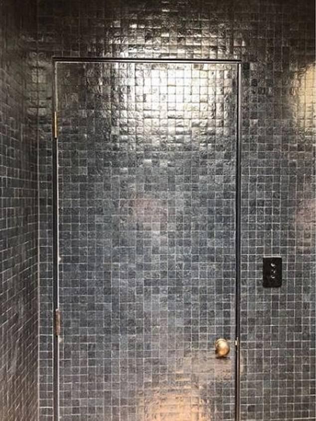 Impressive: The property boasts a 'secret door' leading into the family's powder room