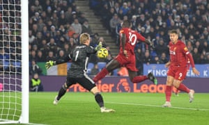 Sadio Mane of Liverpool misses a chance under pressure from Kasper Schmeichel of Leicester City.