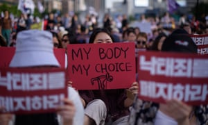 Protesters hold placards reading 'Abolish punishment for abortion' as they protest South Korean abortion laws in Gwanghwamun plaza in Seoul.