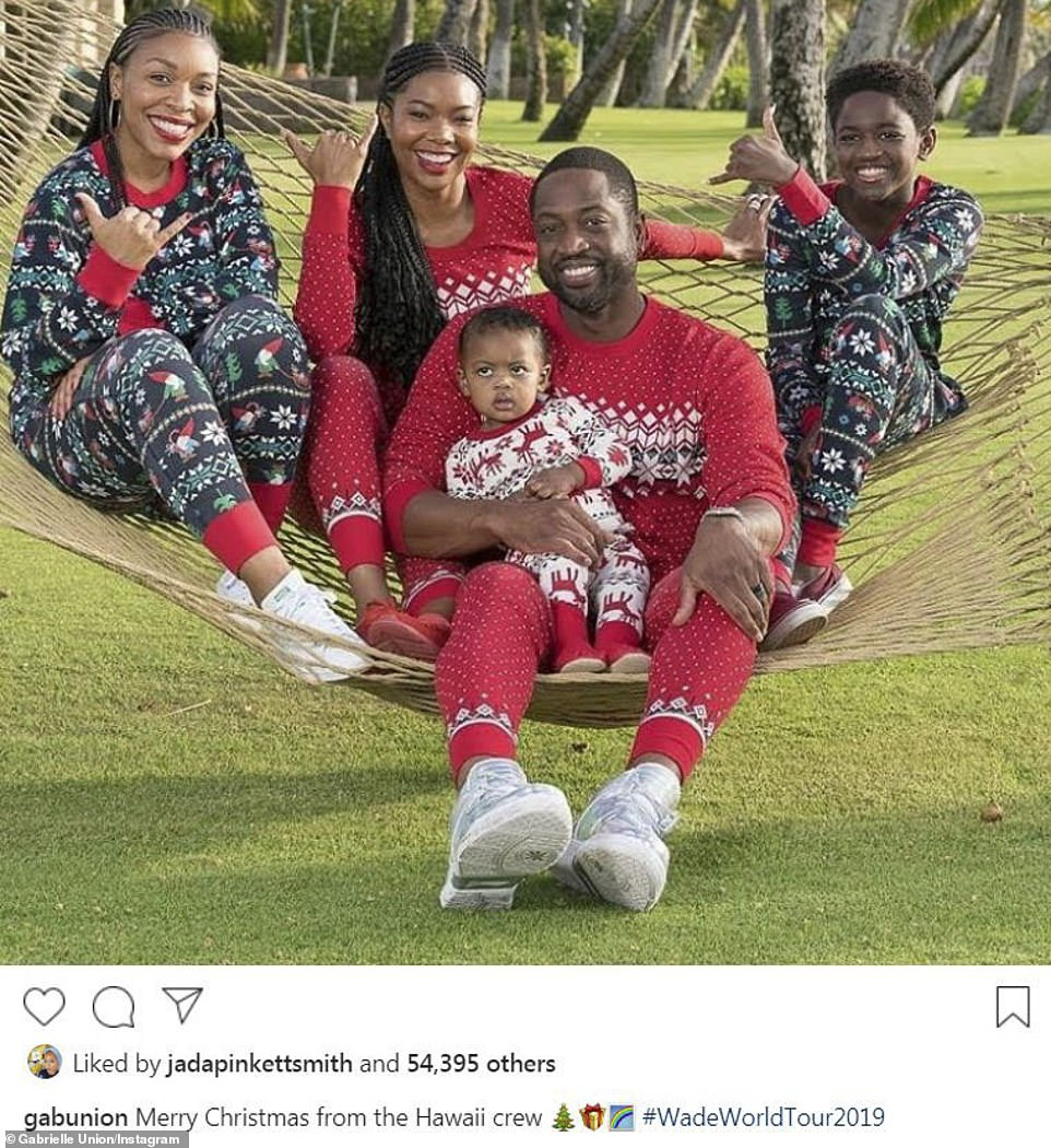 Other holiday vacationers: Gabrielle Union and her family posed on a hammock dressed in Christmas pj's in Hawaii