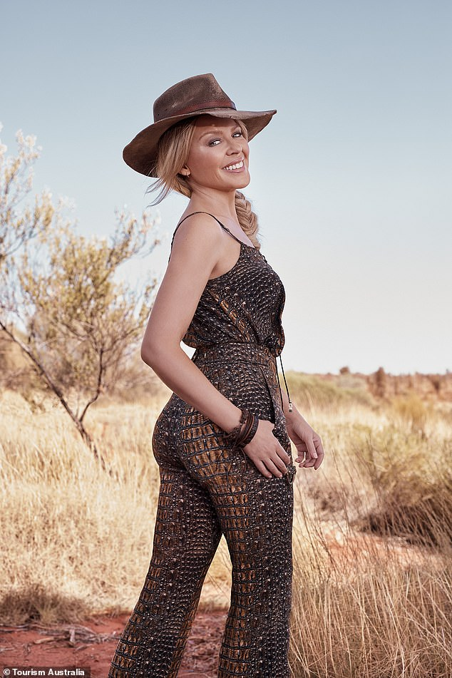 Looking back: Kylie showed off her incredible figure in a mesh jumpsuit and hat