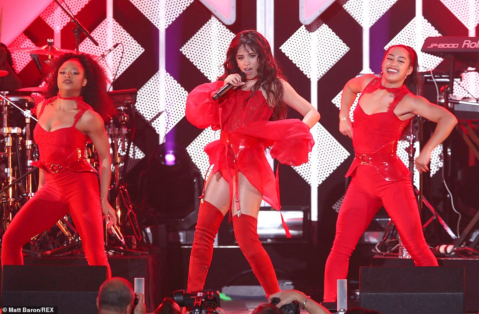 Eyes on her! Camila looked sensational in her matching all red ensemble as she took to the stage to entertain audiences