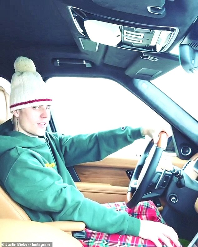 On the road again:Bieber was then seen in a series of videos as he drove while singing Christmas classics such as Santa Claus Is Coming To Town and his song Mistletoe