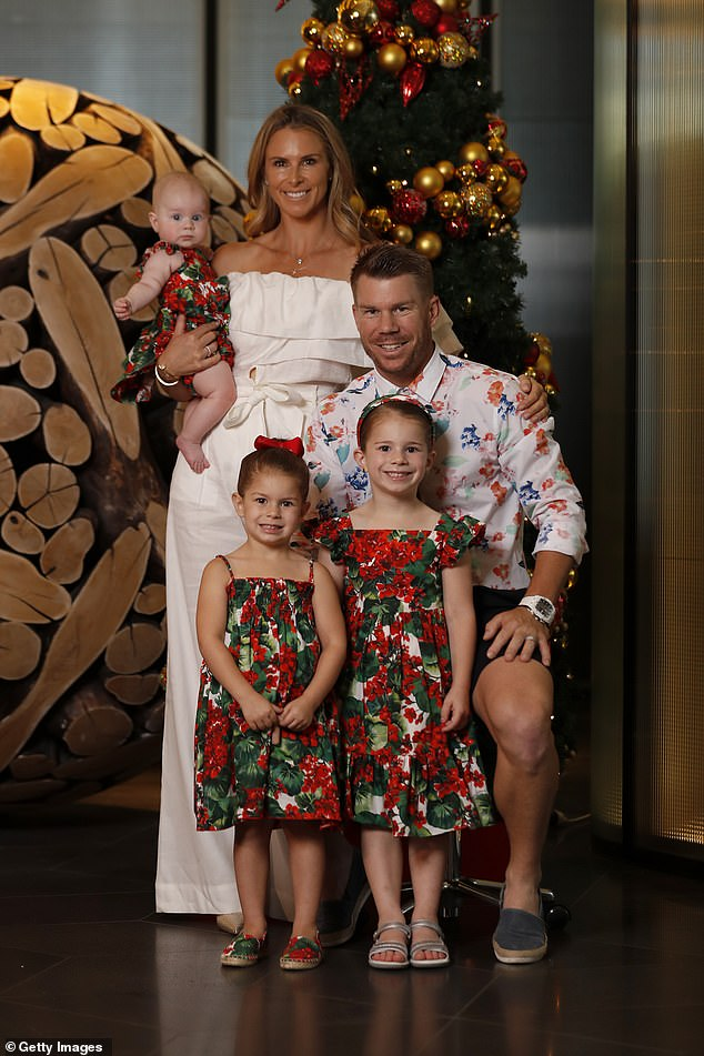 All dressed up! Candice, 34, stunned on the day wearing a white, strapless jumpsuit.They took their three daughters on the outing, Ivy Mae, five, Indi Rae, three, and Isla Rose, five months