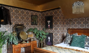 'I can't imagine a time when there won't be a place for pattern in our lives': bold wallpaper in the bedroom.