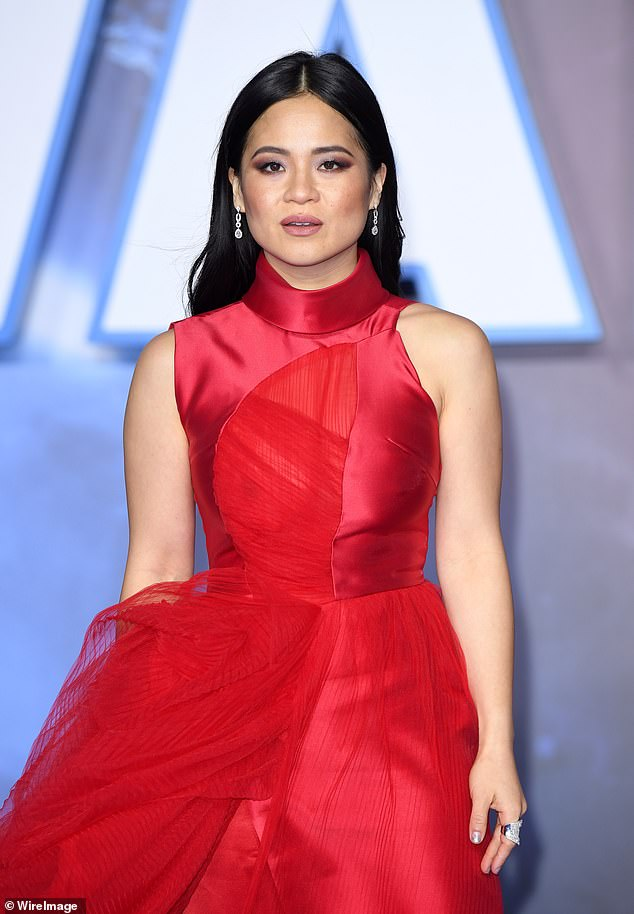 Regal in red: Tran stunned as she stepped out wearing an elegant scarlet red gown to attend the Star Wars: The Rise of Skywalker premiere in London earlier this month