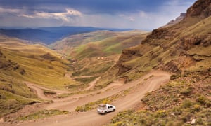 A car driving the hairpin turns of the Sani Pass on the border of South Africa and Lesotho.