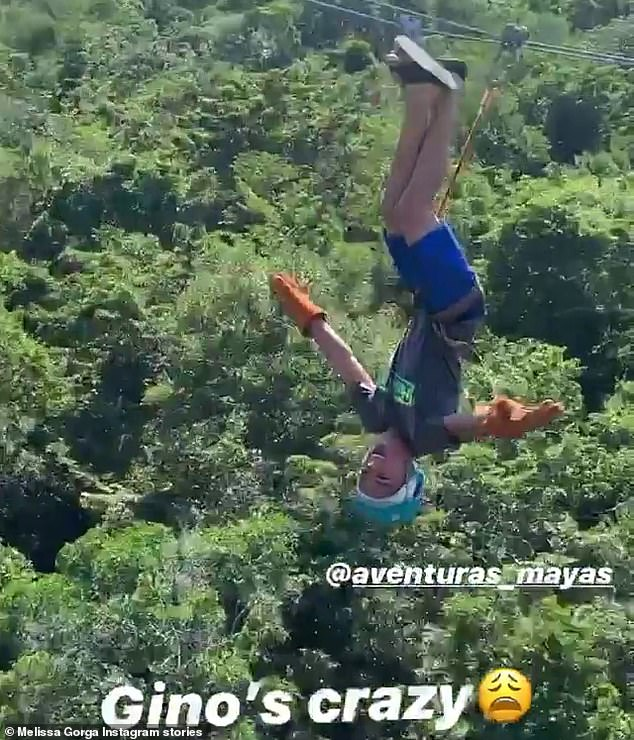 'Gino's crazy': Melissa shared an anxiety-inducing video of her son taking a zip line over the jungle while strapped in upside down