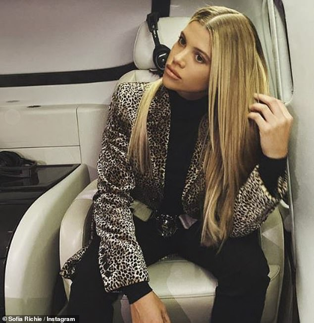 Flight positions: The 21-year-old posted a set of photos of herself posing in the cream leather seat of a luxurious helicopter