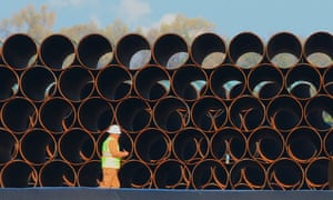 Pipes for the proposed Dakota Access oil pipeline, that would stretch from the Bakken oil fields in North Dakota to Patoka, Ill., are stacked at a staging area in Worthing, S.D.