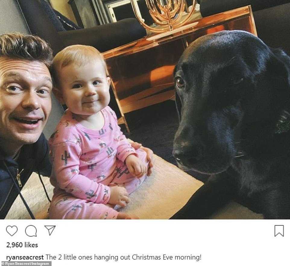 'The 2 little ones hanging out Christmas Eve morning!' Ryan Seacrest posed on his Instagram account with an adorable tot and pup