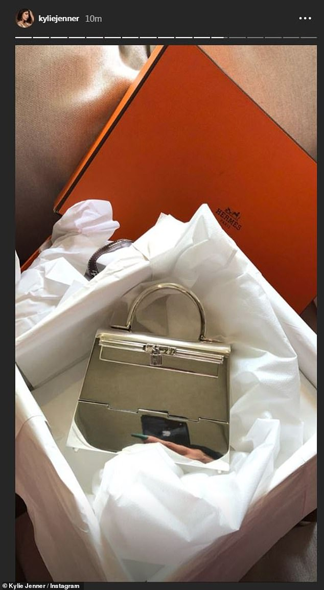 One: Next came several images of her purses. First there was a gold mirror Hermes purse still in its orange box; in the reflection her phone could be seen