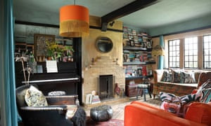 'We just stripped lots of woodchip off the walls and I got painting…' Gold walls in the living-room.