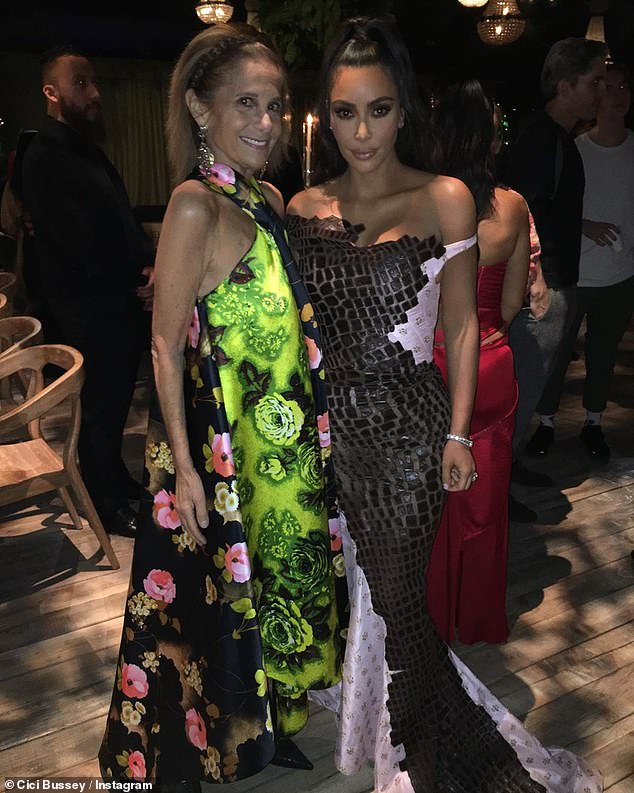 Cici and Kim: Kim also posed with Cici Bussey, who rocked a green and black floral print dress for the occasion