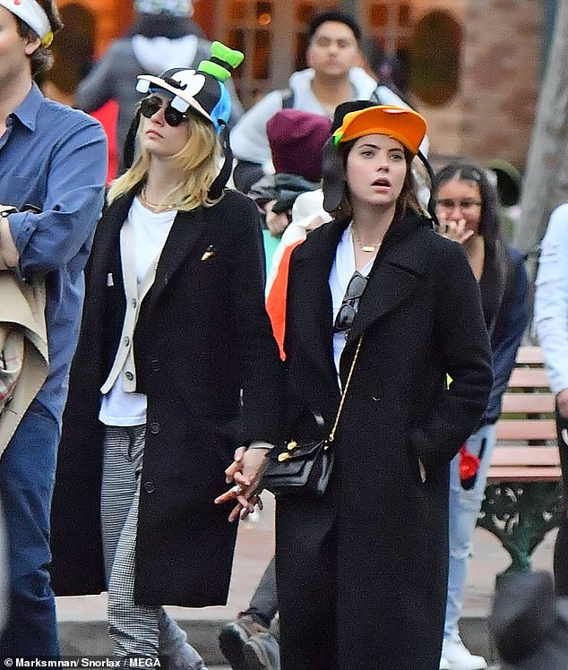 Chic: Ashley accessorised with a stylish black cross body bag and a pair of black frame glasses