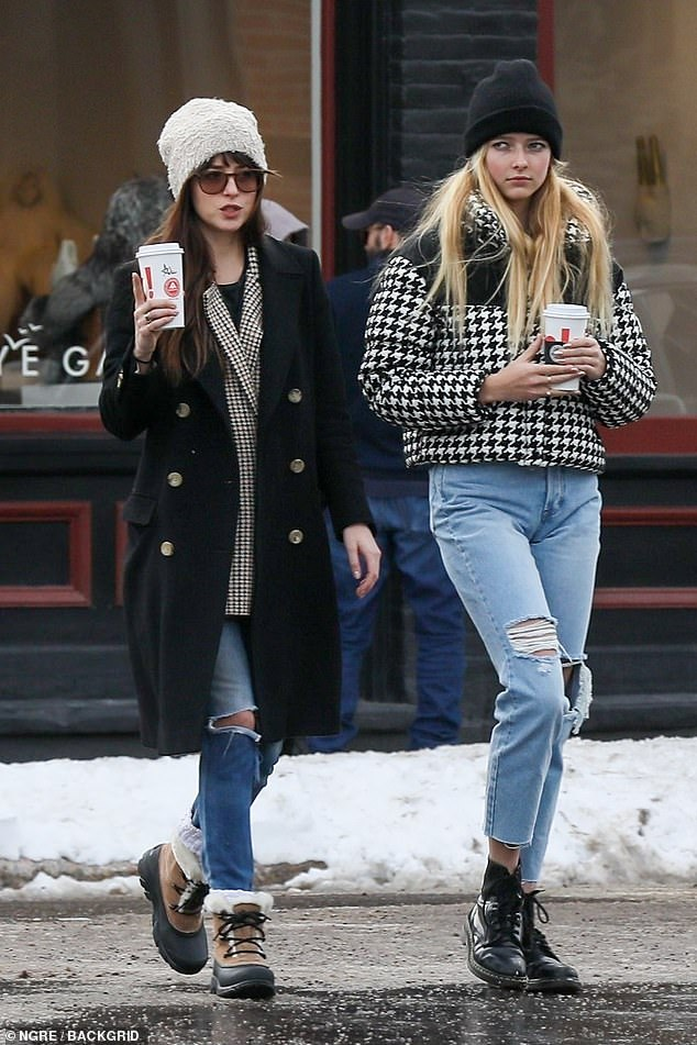 Active:His sighting comes as his actress paramour Dakota was seen joining Martin and his ex-wife Gwyneth Paltrow on their family trip to Aspen. Here Dakota is seen with Martin's daughter Apple on Monday