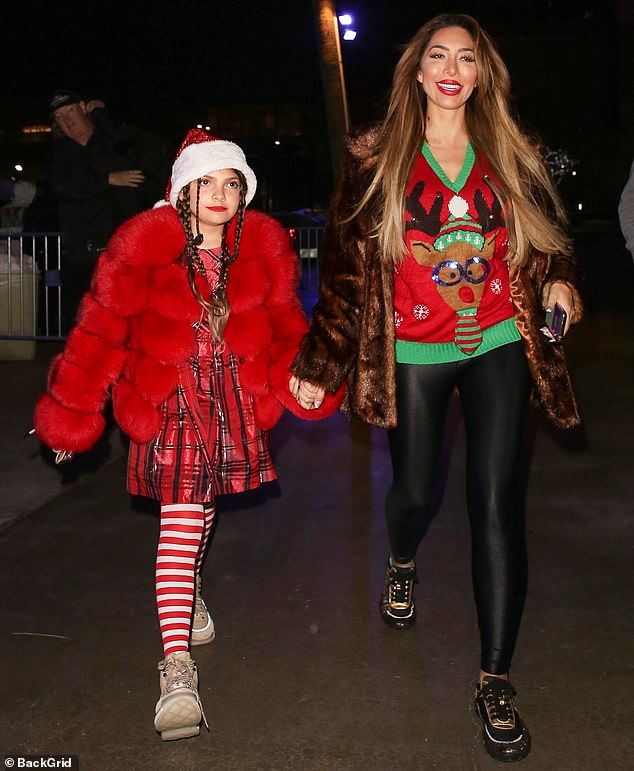 Reality star:Farrah Abraham, 28, also was spotted at the game with her daughter 10-year-old daughter Sophia