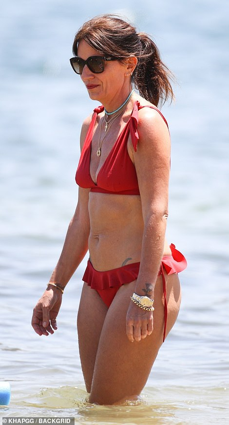 Confident: Davina proudly stepped out in her pretty red frilled two-piece as she enjoyed the sunny break