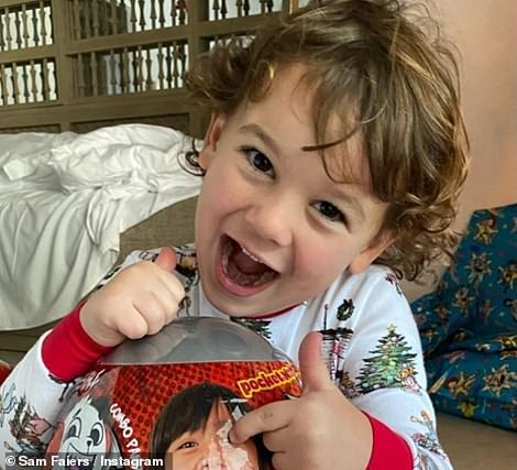 Excitement:The former TOWIE star, 28, went on to share sweet clips of son Paul, four, and Rosie, two, excitedly opening their Xmas presents